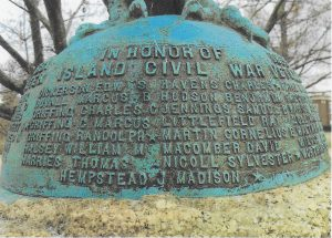 Fig. 1: Shelter Island Civil War Monument. On the monument, and just out of sight in this image, an eagle perches over those who fought in the Civil War. James Madison Hempstead, farmer and whaler, and one of the 178,000 men who fought with the US Colored Troops, is identified with a star as one of those who died. (photograph by Sara Shepherd)