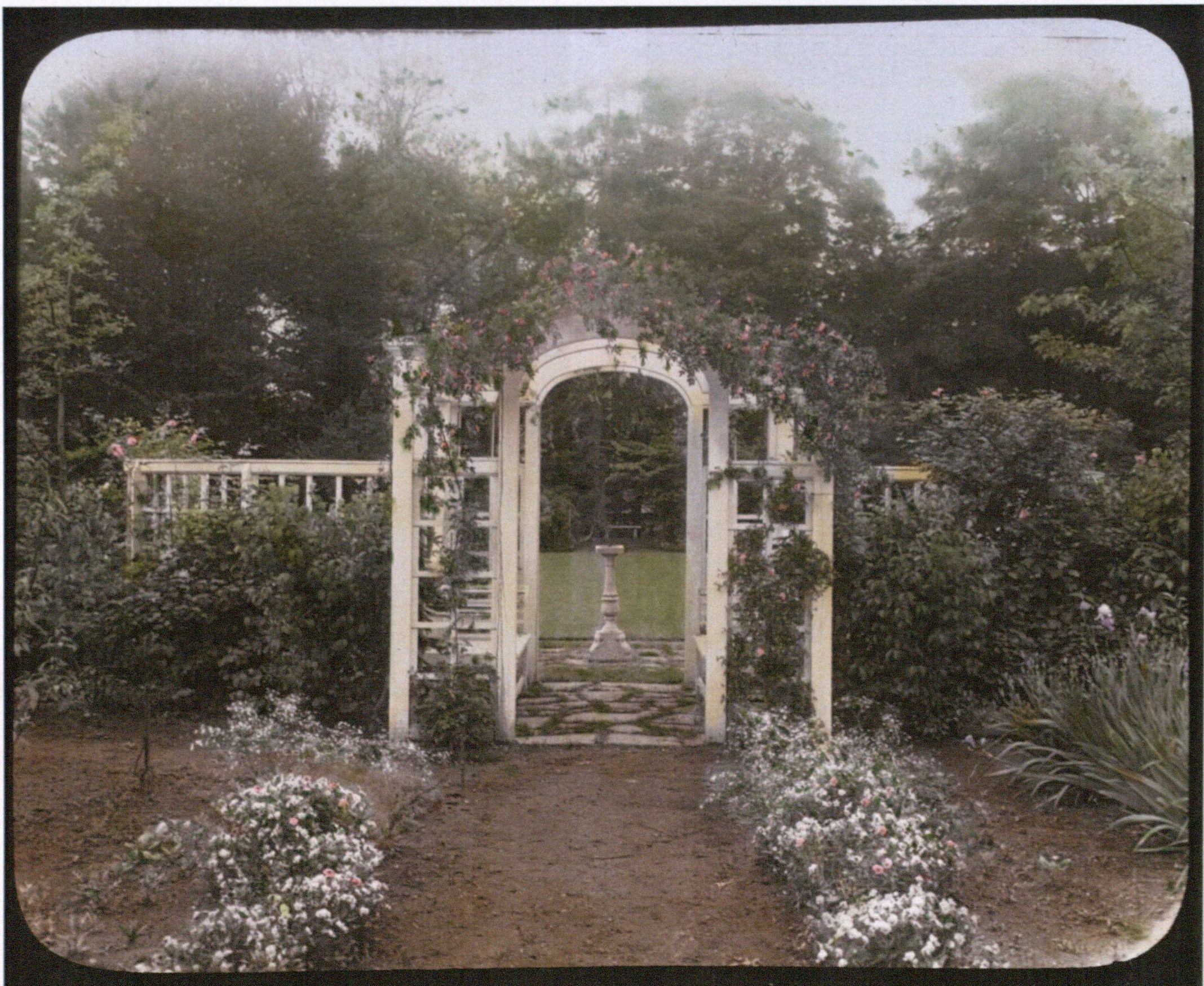 Fanny Mulford's garden including the arbor seat, c. 1916. Photograph by Frances B. Johnston. Courtesy Library of Congress.